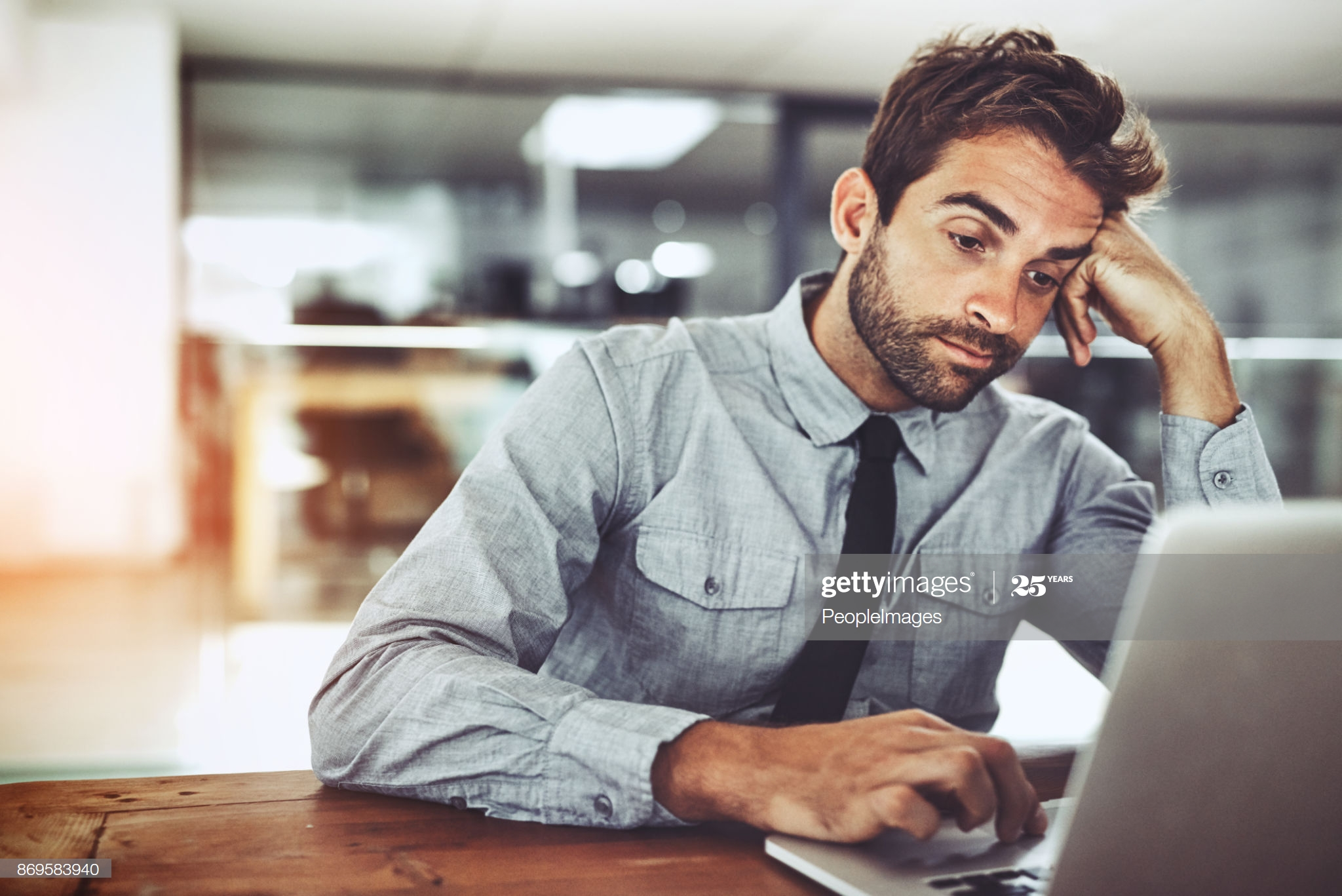 a professional men thinking why WiFi is slower than wired Ethernet connection